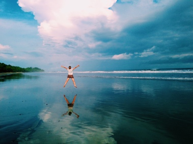 Jumping for joy on the beach in Montezuma